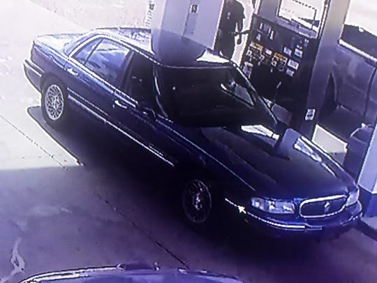 This surveillance image shows a suspect's vehicle connected