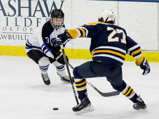 St. Mary's Springs' Levi Poss tries to get by a University School of Milwaukee player Saturday during a sectional final.