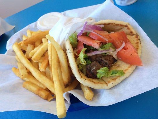 Z's Greek's Gyro sports crispy pita bread, fresh vegetables