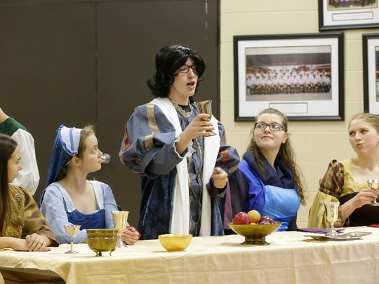 """Children rehearse """"The Prince and the Pauper"""" on Feb. 28, 2018, at the Eden Community Center. Masquerading as the Prince of England, Tom Canty, played by Christian Steffes, toasts the Royal Court. Pictured are, from left: Lily Hernandez, Kayla Doll, Christian Steffes, Sara Titel and Jenna Soldner."""