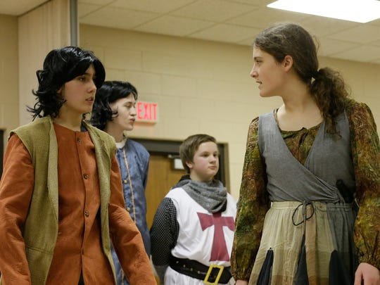 """Children rehearse """"The Prince and the Pauper"""" on Feb. 28, 2018, at the Eden Community Center. Prince Edward, played by John Schauer, dressed as poor beggar Tom Canty,  looks dumfounded as Ma Canty, played by Niah Schauer, tells him again that he's crazy, while the true Tom Canty, dressed as the prince, played by Samuel Schmidt, is guarded by Royal Guard, played by Ethan Poss."""