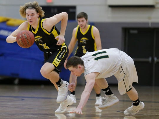 Waupun's Reece Homan breaks away with the ball against Laconia's Cormac Madigan during a March sectional semifinal game.