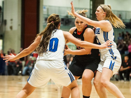 Hardin's Aiyanna Ereaux battles Havre players Kyndall Keller and Kadia Miller during the Class A girls' championship game at Four Seasons Arena Saturday.