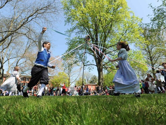 Students at the 81st Dover Days Festival perform a maypole dance.