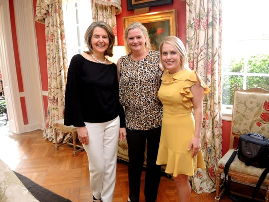 Swan Ball 2018 Auction chairs Jill Talbert, left, Melissa Mahanes and Kathy Davis at the Swan Ball 2018 Auction Wrap-up Party, held at the home of Ellen Martin.