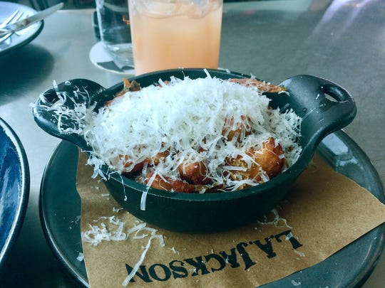 House breakfast potatoes with shredded Parmesan at