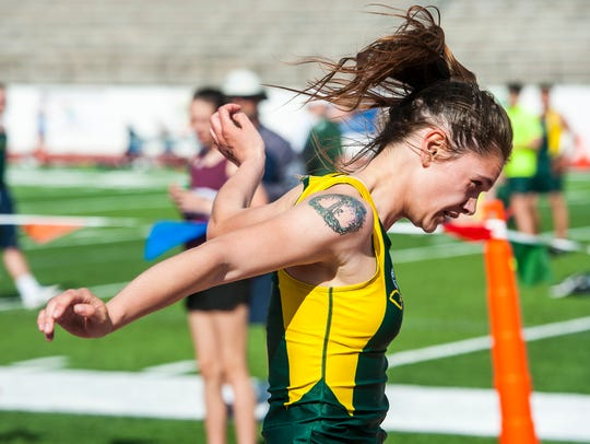 Kaitlin Mason finishes the 100-meter dash during the