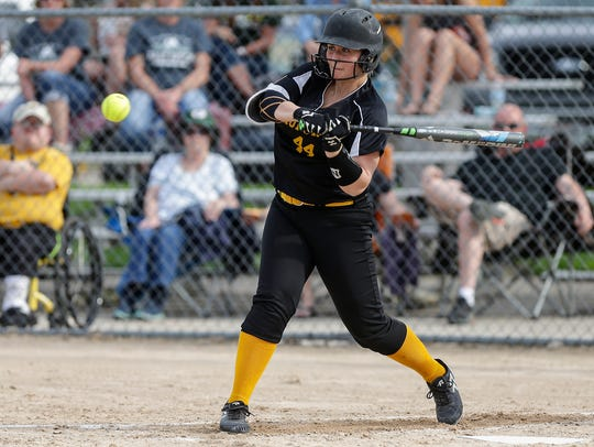 Waupun High School softball's Kylle Hraban swings at