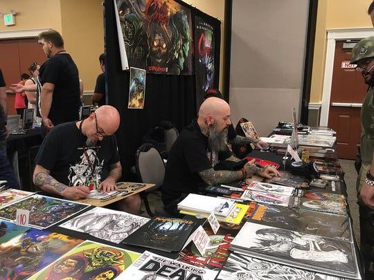 Vendors man a table at Comic-Con 2017.