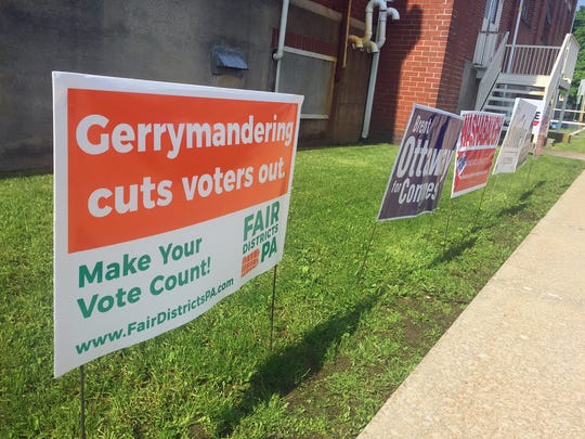 Elections signs are on the grounds at Eugene C. Clark