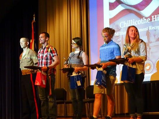 Four graduating seniors are recognized for their decision
