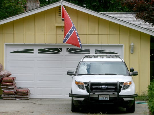 A Washington State Patrol trooper who flew a Confederate flag at his Silverdale home with his official vehicle parked underneath in view of neighbors took the flag down after officials received a public records request inquiring about the flag by the Kitsap Sun.