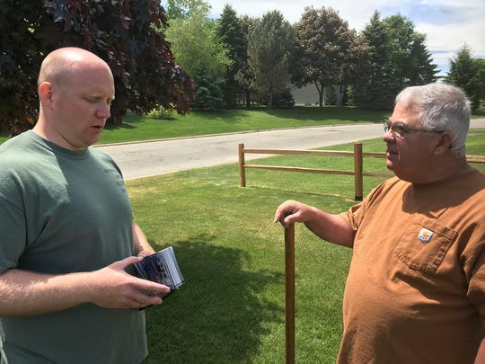 Caleb Frostman (left), who won a seat in the 1st Senate District on Tuesday, talks to Sturgeon Bay voter Tom Fernandez ahead of the election.