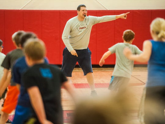 Bobby Howard directs warm up drills during Camp 26,