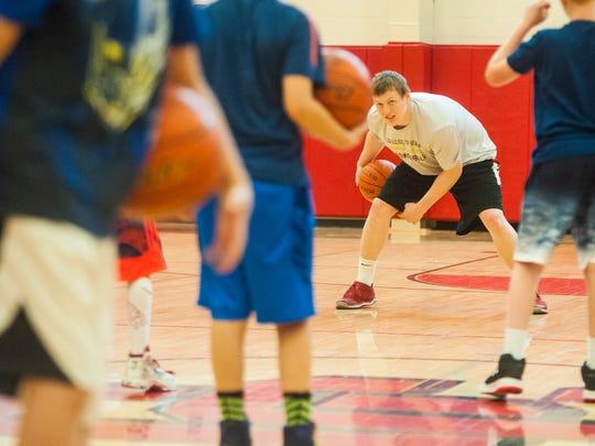Brendan Howard teaches basketball drills to a class
