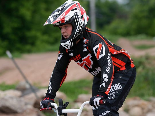 Patrick Beniger II rides the track Thursday, June 21, 2018 at the Fond du Lac BMX Club in Fond du Lac.