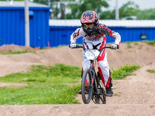 BMX biker Ben Stucky rides the track Thursday, June
