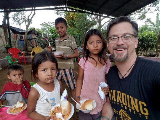 Stephen P. Wolf, outreach minister for Edgemere Church of Christ in Wichita Falls, poses with children during his most recent Nicaragua mission trip. Church officials had been mulling a trip in October, but violence and unrest in that country curtailed their plans.