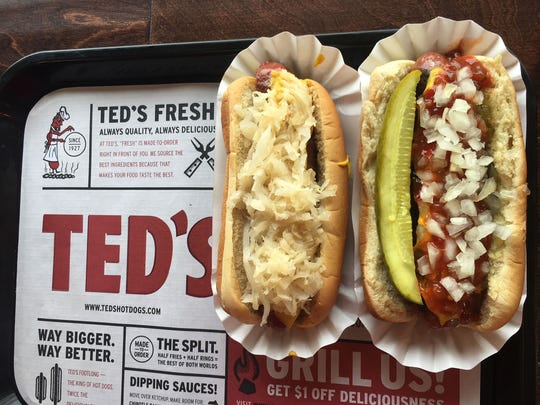 Brats topped with onions and cheese at Ted's Hot Dogs.