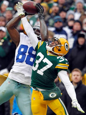 ADVANCE FOR WEEKEND EDITION, JAN. 31-FEB. 1 - FILE - In this Jan. 11, 2015, file photo, Dallas Cowboys wide receiver Dez Bryant (88) catches a pass against Green Bay Packers cornerback Sam Shields (37) during the second half of an NFL divisional playoff football game in Green Bay, Wis. The play was reversed. Concussions, domestic abuse arrests, questionable officiating and another cheating controversy. And yet, the league still popular as ever with ratings and revenue streams that make other leagues jealous.  (AP Photo/Matt Ludtke, File)