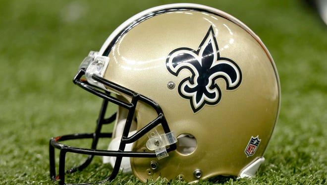 A detail of a New Orleans Saints helmet  at Mercedes-Benz Superdome.