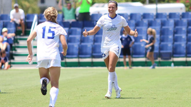 Darien Davis, left, runs up to Tabby Tindell to celebrate Tindell's record-breaking goal, which came in the first half of FGCU's game against Dayton on Sunday.