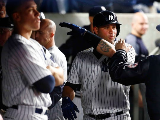 New York Yankees catcher Gary Sanchez (24) celebrates after hitting a home run in the seventh inning against the Minnesota Twins at Yankee Stadium.