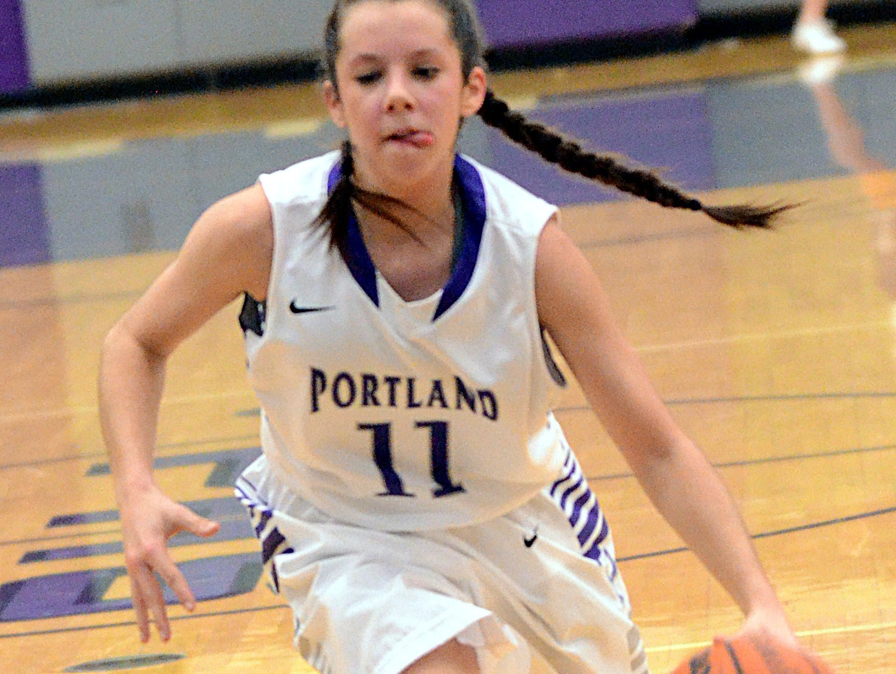 Portland High sophomore point guard Rachel Jennings dribbles into the lane during second-quarter action. Jennings scored five points.