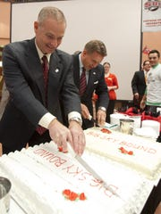 In this file photo, Southern Utah University's Athletics Director Ken Beazer and President Michael Benson cut cake in celebration of SUU receiving an invitation to join the Big Sky Conference during a press conference in the Sharwan Smith Rotunda on campus in Cedar City.