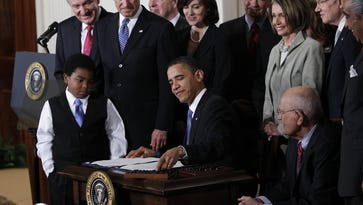 President Barack Obama reaches for a pen to sign the Affordable Care Act legislation on March 23, 2010. Part of the legislation requires that menus include information about food content.