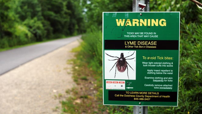Information on the prevention of Lyme disease and other tick borne diseases is displayed on the Dutchess County Rail Trail in the Town of LaGrange in this file photo.