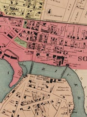 A detail from an 1869 map shows a dense cluster of businesses (pink portions) in the vicinity of what is now the Winooski traffic circle. Stevens House — a hotel — stands at the site of the hotel now proposed by developer Adam Dubroff. The map was published by the F. W. Beers & Co