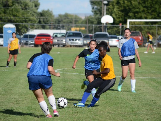 Bloomfield's Vanessa Harris, in yellow, passes the ball down the right side during Wednesday's practice.