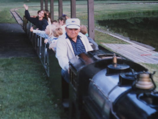 Bernard Bowman runs his train around a pond he dug