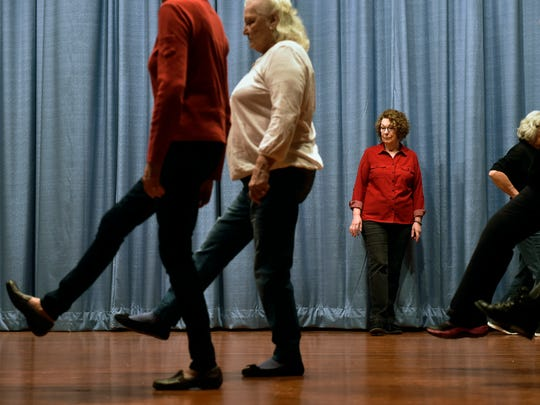 Linda Sulc, 72 of Red Lion, watches as fellow seniors practice basic tap dance steps at a beginner tap dance class Friday, Jan. 20, 2017, at Windy Hill on the Campus Senior Center in Jackson Township. More than a dozen people attended the first class; if interest is sustained, more classes will be held on subsequent Fridays.