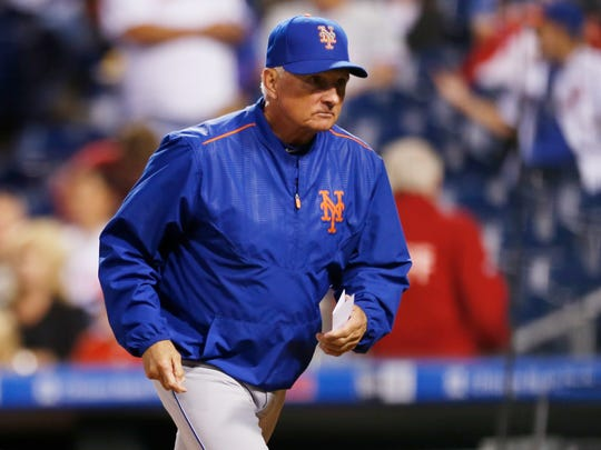 New York Mets manager Terry Collins runs to the dugout before the start of a baseball game against the Philadelphia Phillies, Friday, Sept. 29, 2017, in Philadelphia.