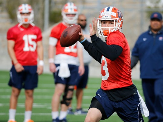 Former Eastwood Trooper quarterback and UTEP sophomore Mark Torrez looks for his receiver downfield during the first day of spring practice at Glory Field, under new head coach Dana Dimel.