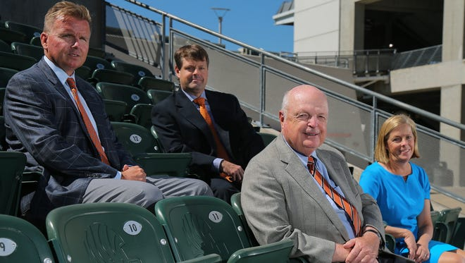 From left: Troy Blackburn, Paul Brown, Mike Brown and Katie Blackburn, pose for a portrait, Tuesday, July 25, 2017, at Paul Brown Stadium in Cincinnati. The Brown family is celebrating 50 years this year as owners of the Cincinnati Bengals franchise.