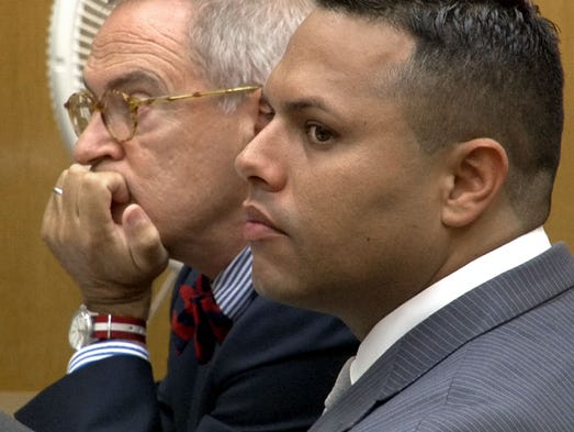 Erick Uzcategui is shown during the opening arguments in his trial in State Superior Court in Toms River Tuesday, July 1, 2014, with his attorney Brian Neary.   He is charged with the vehicular homicide of Ocean Gate Police Officer Jason Marles.    ~