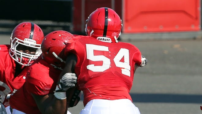 Rutgers has instituted a new rugby-style tackling system that coach Chris Ash brought with him from Ohio State.