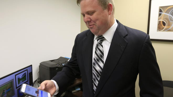 Attorney Rick Davis accesses his chat room while in his office in Leawood, Kansas. Davis uses text and chat to communicate with his clients.
