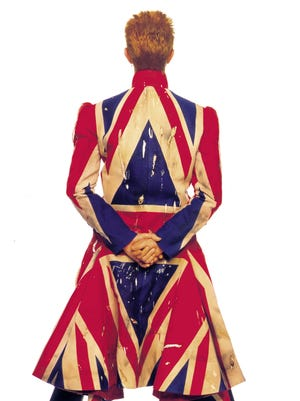 "David Bowie made it home after his arrest in 1976 in Rochester. Here he poses in a Union Jack-styled coat designed by Alexander McQueen for the ""Earthling"" album cover in 1977."