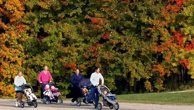 Idlewild Park - Burlington Runners jog along a road in England-Idlewild Park, Burlington, against a backdrop of fall color.