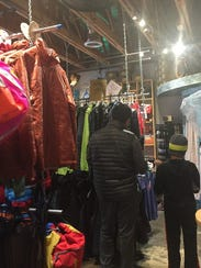 Midtown shoppers check out the sale rack at Happy Hiker.