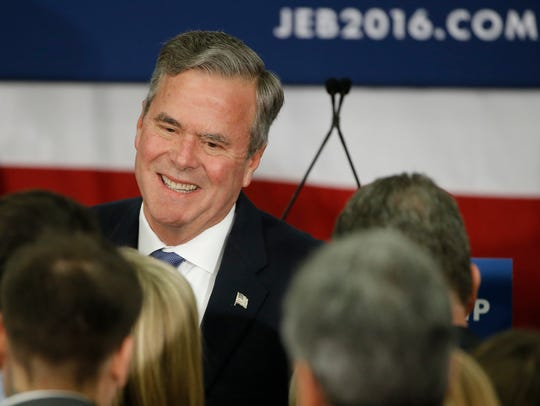 Former Florida governor Jeb Bush meets with supporters
