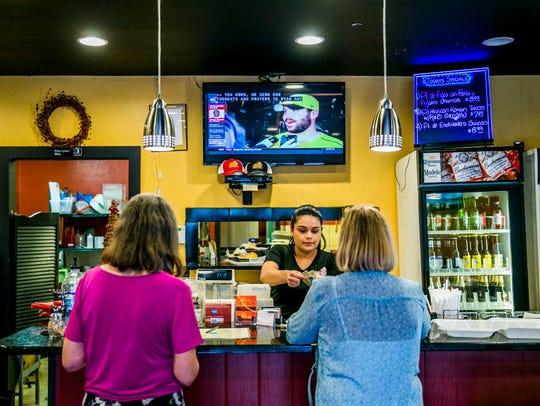 Mindy Serpas works the register at Mi Ranchito restaurant