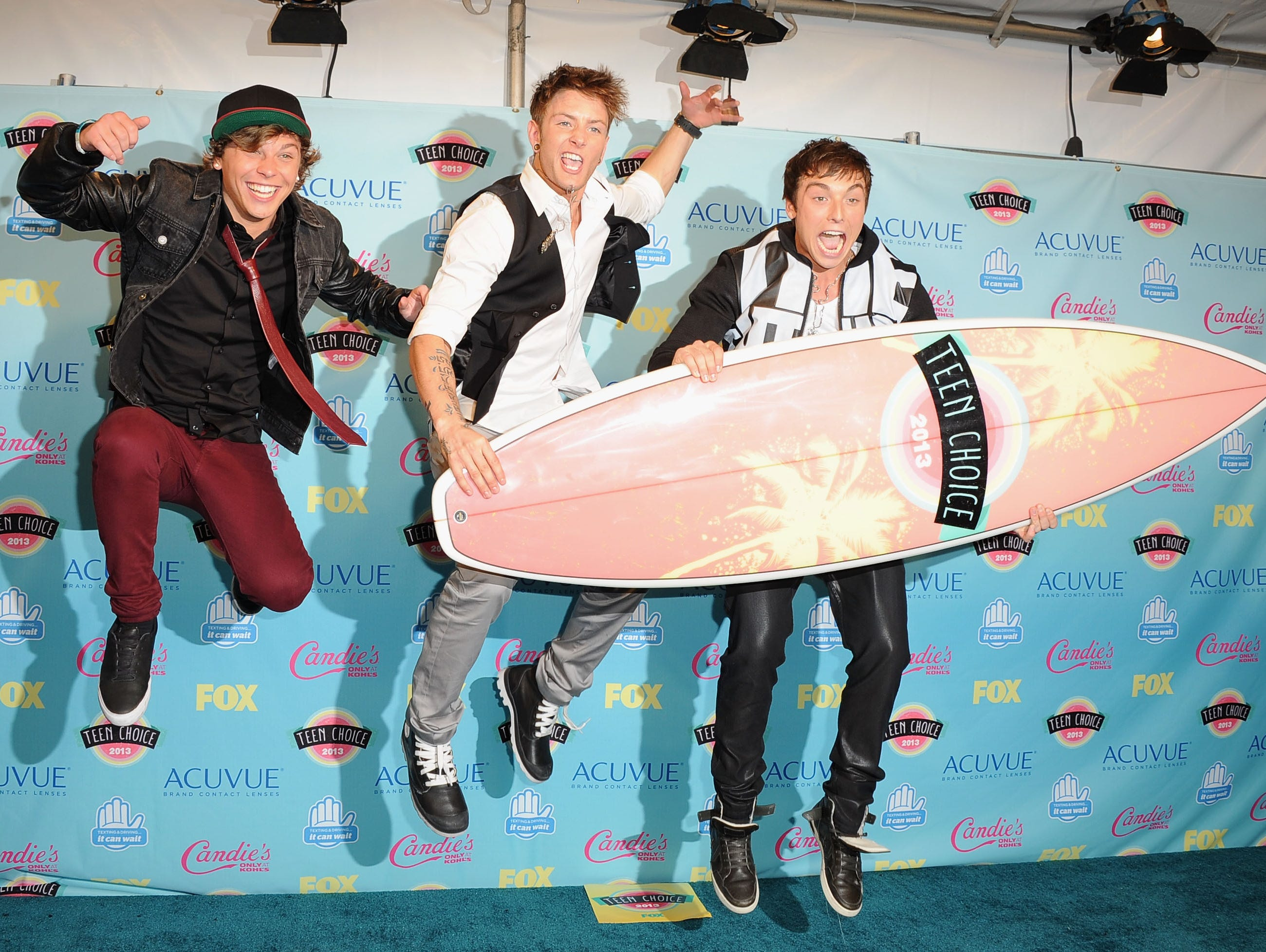 Keaton Stromberg, Drew Chadwick, and Wesley Stromberg of Emblem3 pose in the press room.