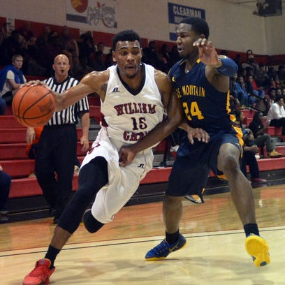 William Carey's Leo Garrett (15) drives to the basket