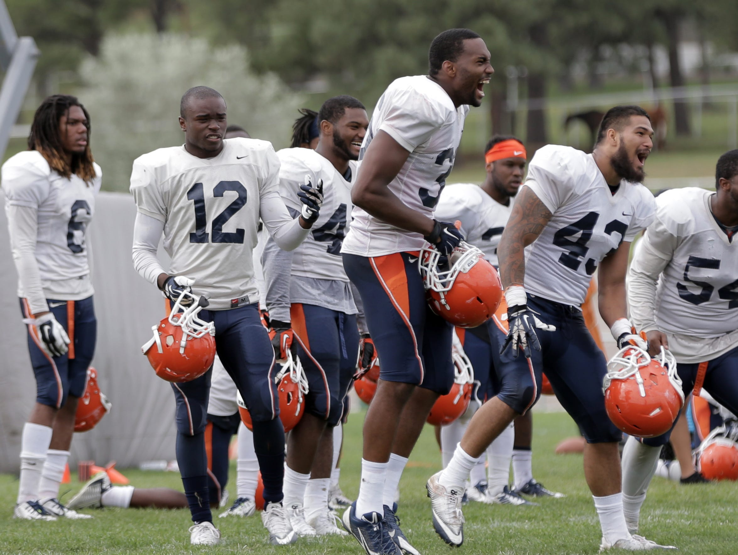 UTEP defensive players get exctited after a their squad