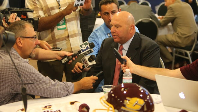 Central Michigan head football coach John Bonamego talks with reporters during the MAC media day July 29, 2015 at Ford Field in Detroit.